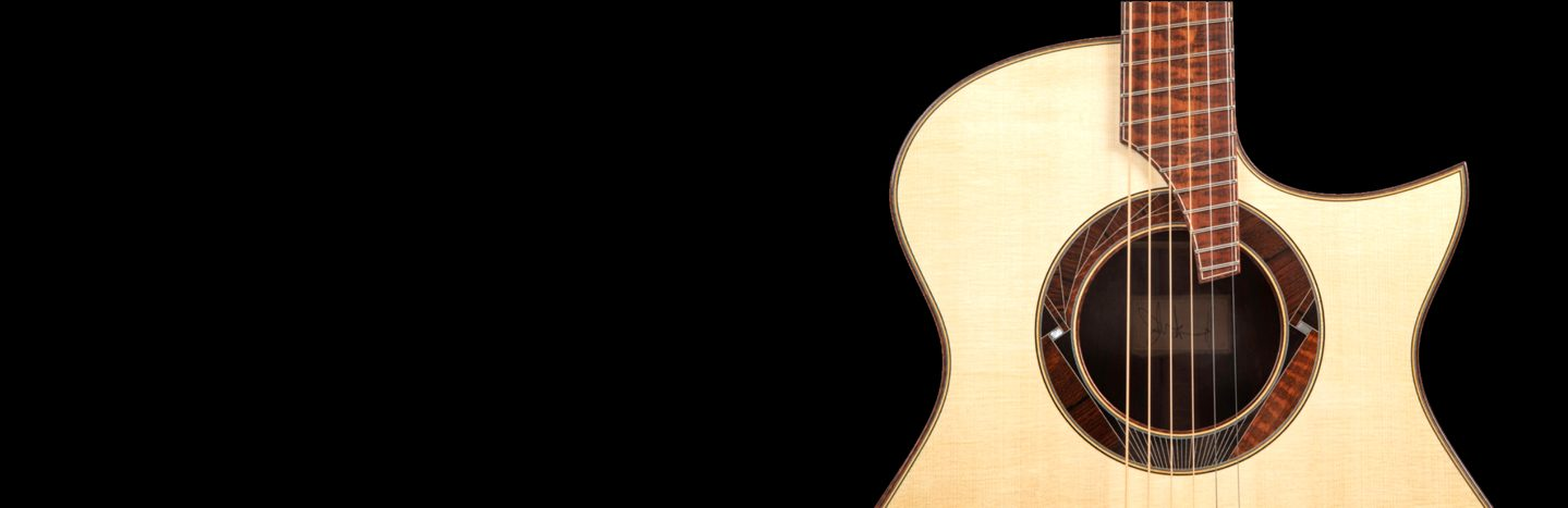 Guitar In Front of Black Background