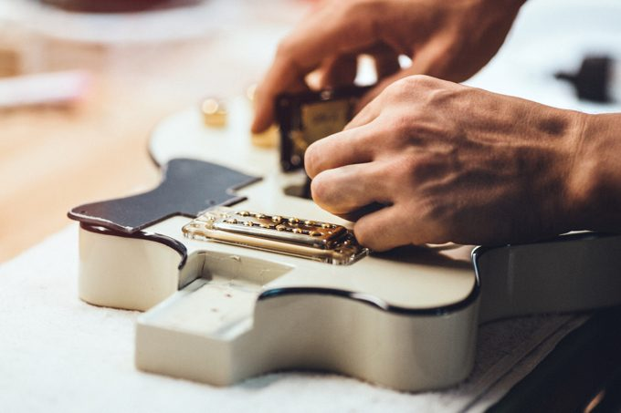 Guitar Repairs Being Performed By A Repair Technician